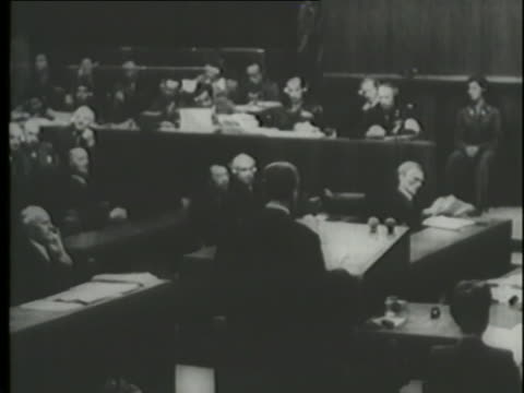 a man addresses the room at the nuremberg trials. - nuremberg trials stock videos & royalty-free footage