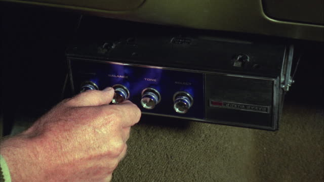 cu man adjusting car stereo in police car - radio stock videos & royalty-free footage