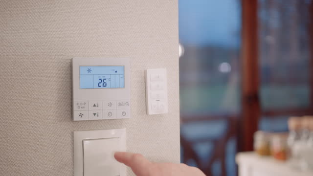 man adjusting digital thermostat - adjusting stock videos & royalty-free footage