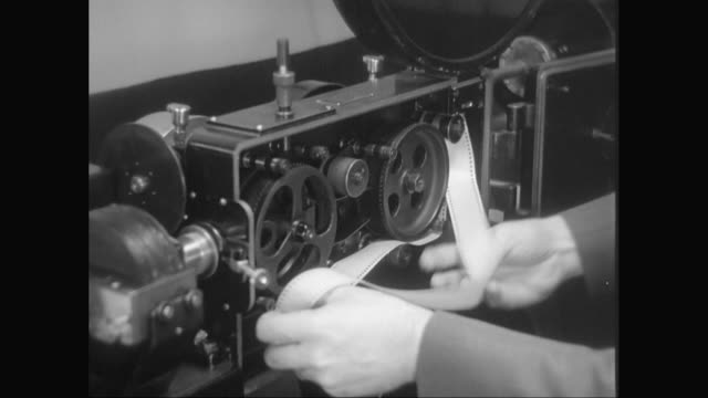 ms man adjusting reel in film projector / united states - film stock videos & royalty-free footage