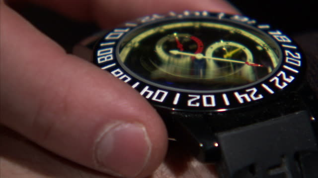 ecu man adjusting watch on his wrist - wrist watch stock videos & royalty-free footage