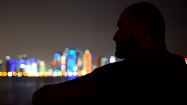 Man admiring the view. Cityscape in the night