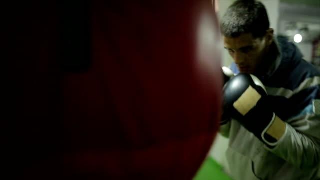 man against punching bag