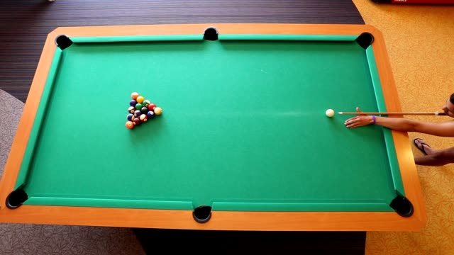 man aiming at pool ball during billiard game - aiming stock videos and b-roll footage