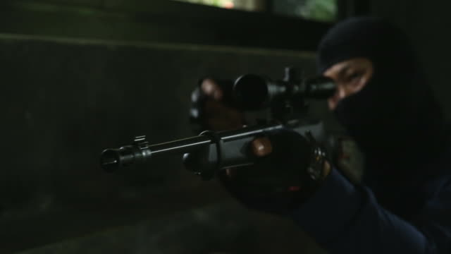 man aiming with rifle - aiming stock videos and b-roll footage