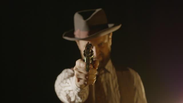 man aims revolver gun at camera and pulls trigger - handgun stock videos & royalty-free footage