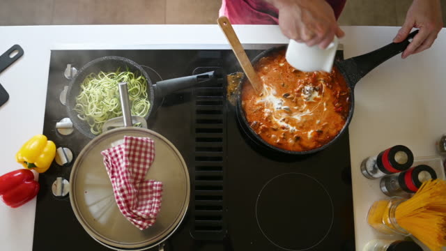 diy man alone home cooking spaghetti during covid-19 - cooking stock videos & royalty-free footage
