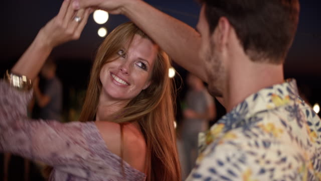 man and a red haired woman dancing and talking at a party in the evening - shoulder stock videos & royalty-free footage