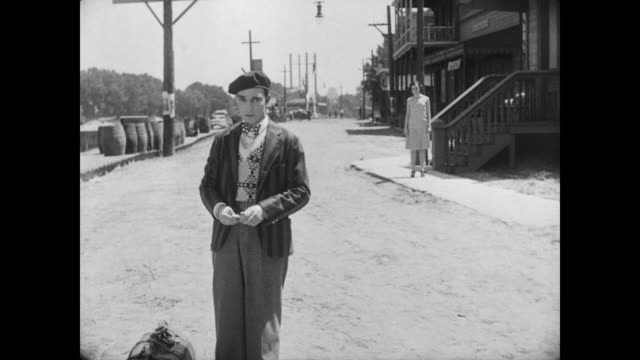 1928 a man (buster keaton) and a woman (marion byron) are hesitant to speak to one another - tearing stock videos & royalty-free footage