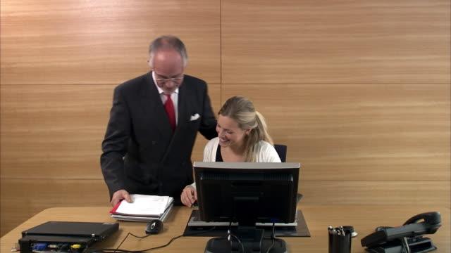 stockvideo's en b-roll-footage met a man and a woman in an office sweden. - uitvoering