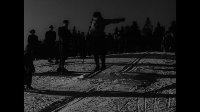 man and boy next to him walking on skis / boy starts skiing down slope / boy walking on skis / boy skiing / boy skiing sitting down / man and boy... - nordic skiing event stock videos and b-roll footage