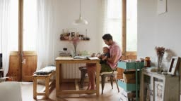 Man and boy playing with toy at table in kitchen
