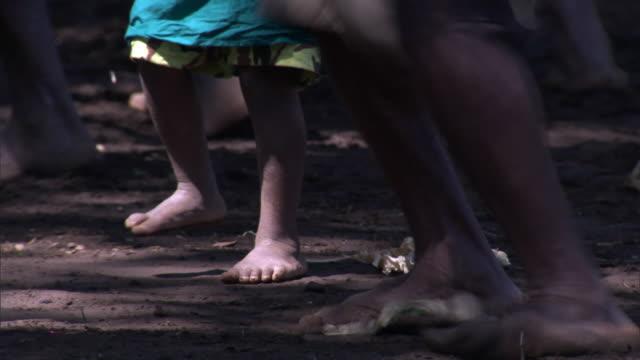 vídeos de stock, filmes e b-roll de man and child dance at tribal toka festival, tanna island, vanuatu - festival tradicional