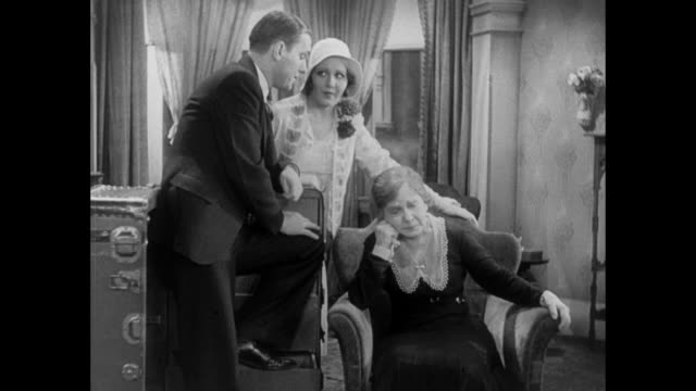 1931 man (pat o'brien) and fiance (mary brian) break news of engagement to weeping mother - 1931 stock videos & royalty-free footage