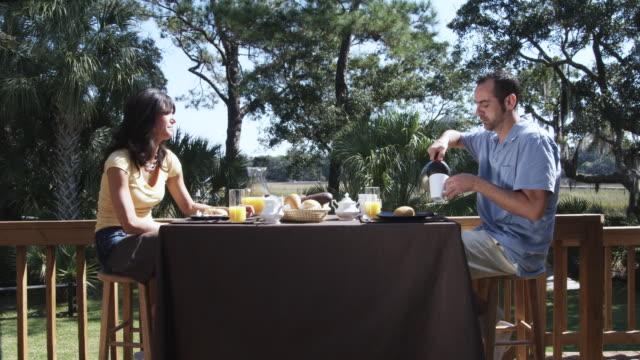 ms man and girlfriend having breakfast / charleston, south carolina, usa - teekessel stock-videos und b-roll-filmmaterial