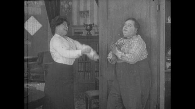 1917 man (fatty arbuckle) and his boss get into a physical altercation - bad news stock videos & royalty-free footage