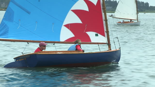 a man and his daughter sail their beetle cat sailboat in a race in quonochontaug pond, rhode island. - daughter stock videos & royalty-free footage
