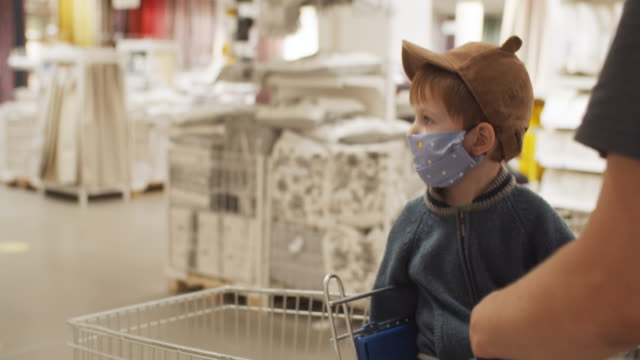 man and his little boy in protective mask in a shopping mall during pandemic - choice stock videos & royalty-free footage