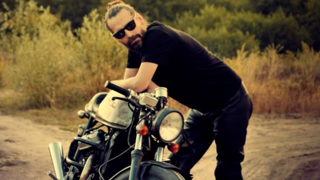 man and his machine. custom motorcycle - leather jacket stock videos & royalty-free footage