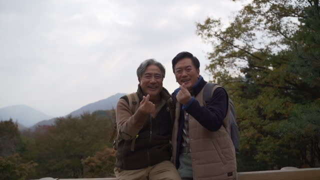 a man and his old friend in their 60s making korean finger heart with a big smile / yangpyeong-gun, gyeonggi-do, south korea - human nose stock videos & royalty-free footage