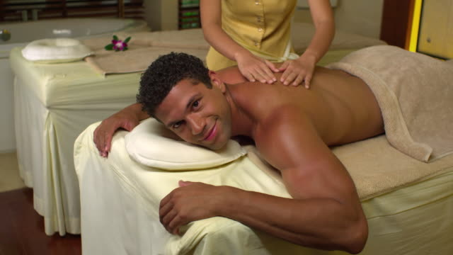 ms man and man receiving massage in spa, krabi, thailand - see other clips from this shoot 1459 stock videos and b-roll footage