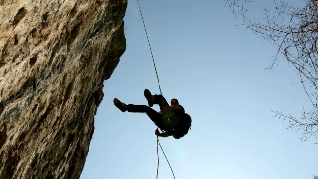 man and rock climbing - climbing equipment stock videos and b-roll footage