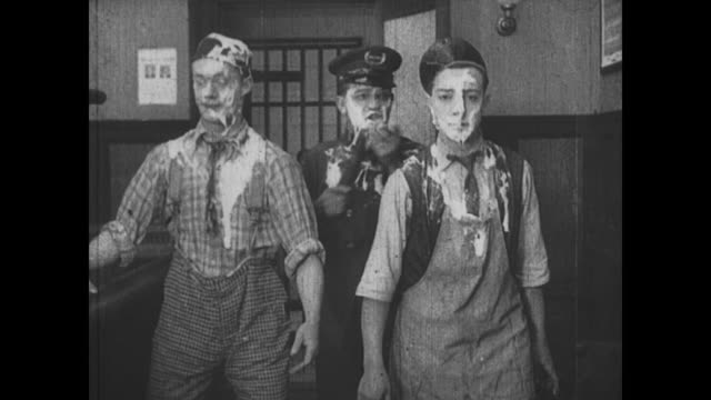 1917 man (buster keaton) and the chef, covered in dough, are brought before a judge - sentencing stock videos & royalty-free footage