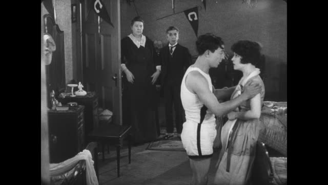 1927 man (buster keaton) and the popular girl live happily ever after - slapstick video stock e b–roll