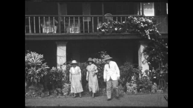 man and two women in the garden of their house - colonial stock videos & royalty-free footage