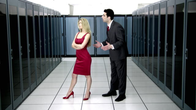 ws man and woman arguing in server room - see other clips from this shoot 1480 stock videos and b-roll footage