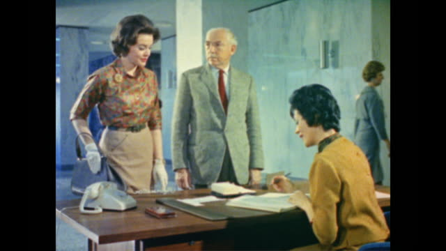 1962 man and woman arrive at social security adminstration home office - 社会保障点の映像素材/bロール