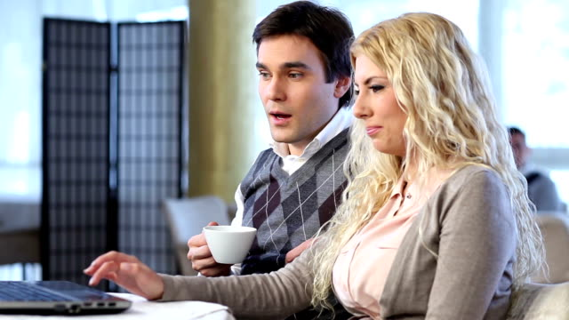 man and woman at the cafe using laptops. - hoozone stock videos and b-roll footage