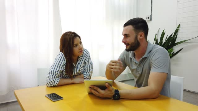 man and woman at the office working together. - two people stock videos & royalty-free footage