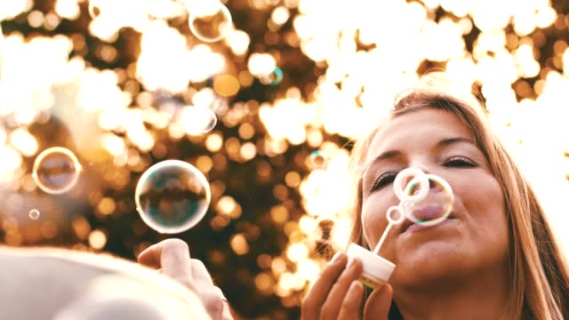 man and woman blowing bubbles - mid adult couple stock videos & royalty-free footage