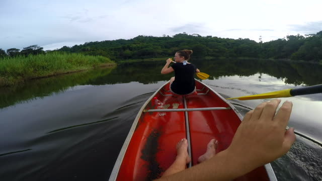 POV Man and Woman Canoeing Lagoon