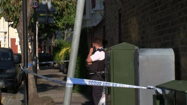 Man and woman charged with murder after badly burned body found in garden of house in Southfields ENGLAND London Southfields EXT Property where...