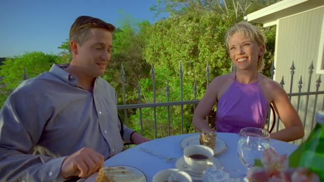 ms zo cs slo mo man and woman chatting at table outdoors, waiter serving dessert / canyon lake, texas, usa - canyon lake stock videos & royalty-free footage