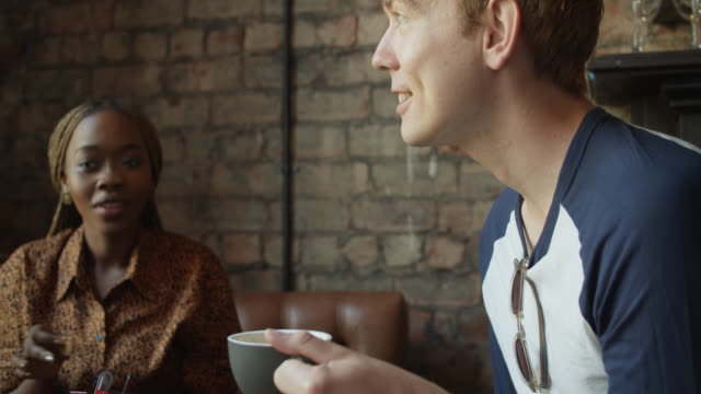 man and woman chatting over coffee - pub stock videos & royalty-free footage