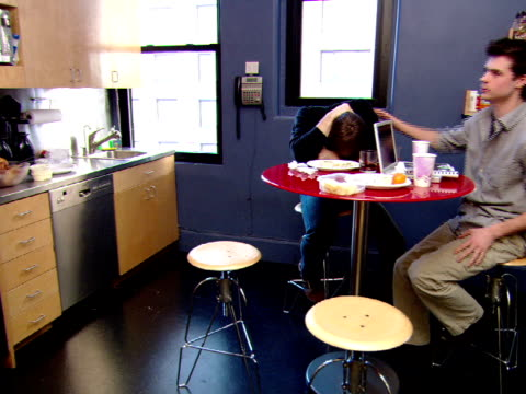 ms, pan, man and woman consoling friend in office lunch room - comforting colleague stock videos & royalty-free footage