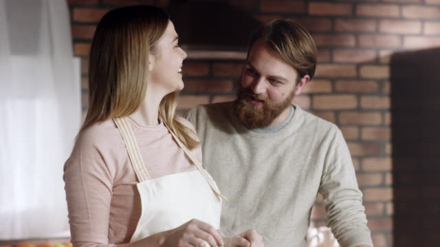 Man and woman cooking together at kitchen
