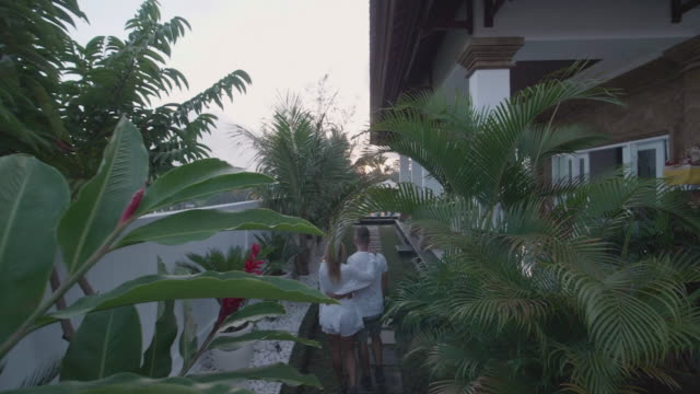a man and woman couple arriving to a villa resort in exotic tropical bali, indonesia. - ubud district stock videos & royalty-free footage