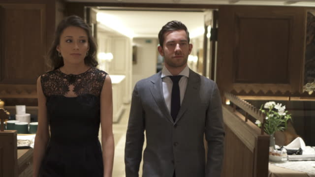 a man and woman couple walking into a luxury restaurant. - dekoration stock-videos und b-roll-filmmaterial