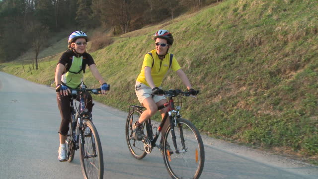 ms ds man and woman cycling in rural landscape, vrhnika, slovenia - vrhnika stock videos & royalty-free footage