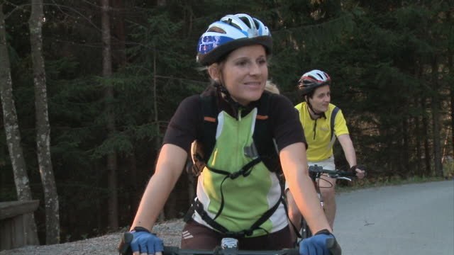 slo mo ms ds man and woman cycling in rural landscape, vrhnika, slovenia - vrhnika stock videos & royalty-free footage