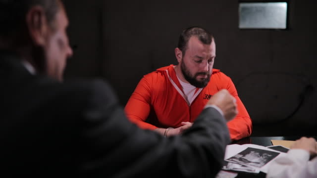 man and woman detectives interrogating a prisoner - prisoner orange stock videos & royalty-free footage