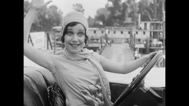 vídeos de stock, filmes e b-roll de 1928 a man (tom mcguire ) and woman (marion byron) embrace upon her arrival in a fancy sports car - 1920