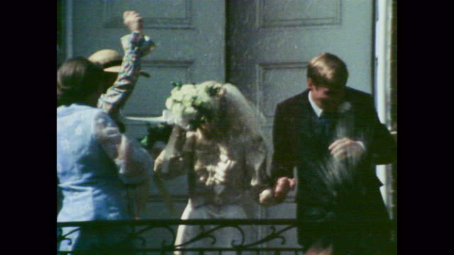 1978 a man and woman emerge from church on their wedding day as narrator john wayne talks about working hard - 1978 stock videos & royalty-free footage