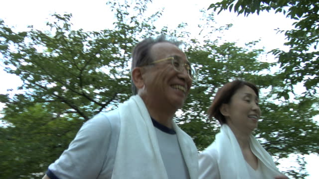 man and woman enjoying jogging - only japanese stock videos & royalty-free footage
