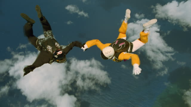 man and woman exit airplane and go skydiving - skydiving stock videos & royalty-free footage