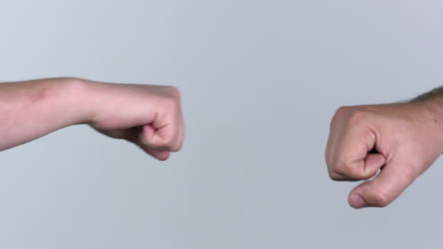 Man and woman fist bump